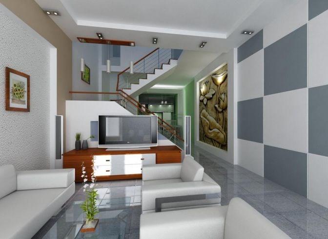 Sofa trắng trên nền gạch xám kết hợp cùng họa tiết trang trí tường cho không gian phòng khách thêm tinh tế.
